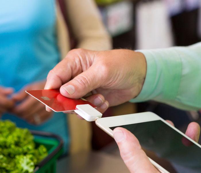 Man swiping credit card through machine