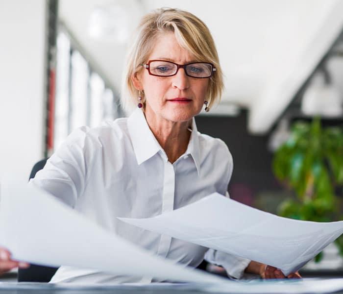 Older woman organizing paperwork