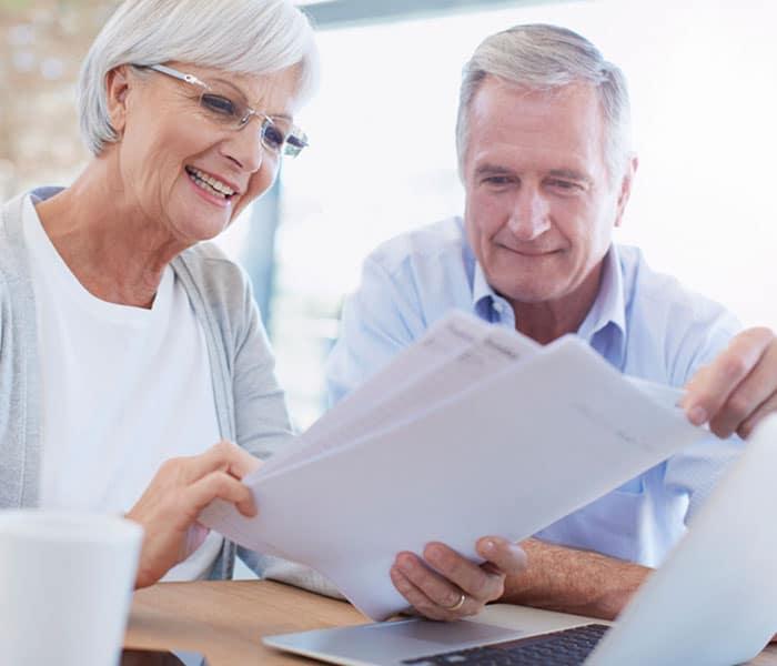 Older couple looking over paperwork