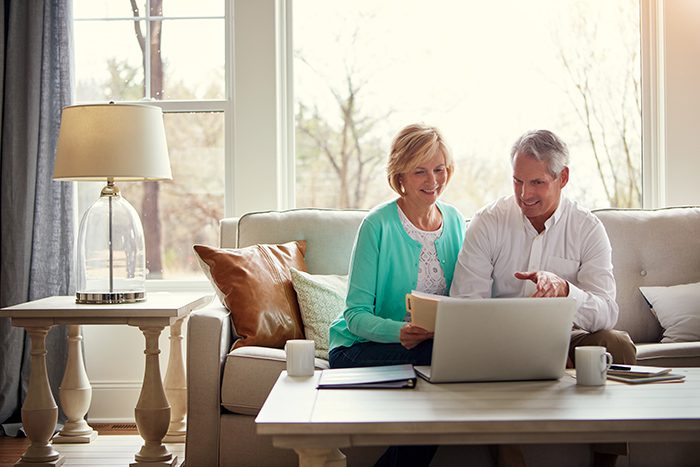 Shot of a mature couple going over their finances at home