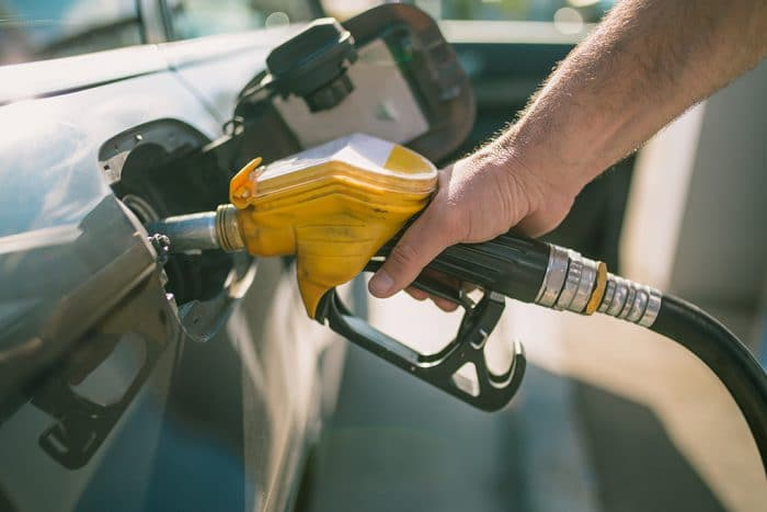 Car refueling on petrol station. Man pumping gasoline oil.