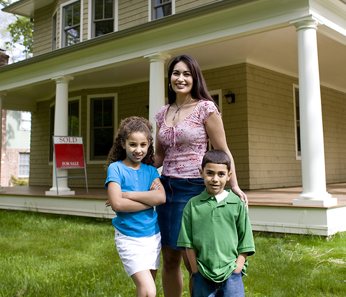 Single Mom with Kids Outside New House photo