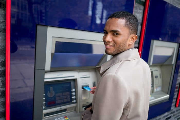 Business man making a cash withdrawal on an ATM