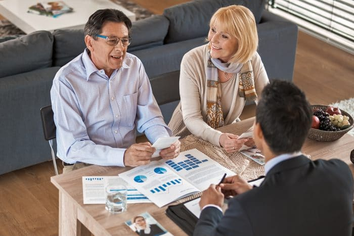 Banker discussing with senior couple