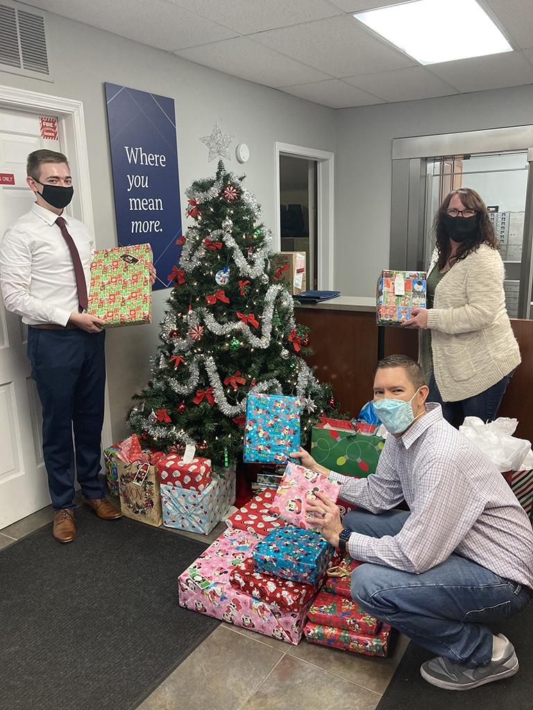 employees around a christmas tree