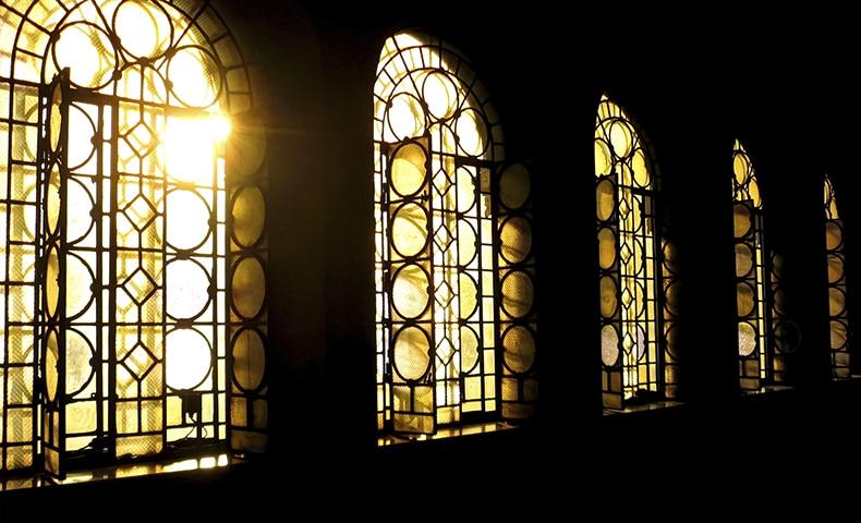 Ray of sun in church corridor